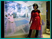 Avatar Bride: Picard using voice communication ( note headset) to communicate with 3D avatar bride in cybersapce.